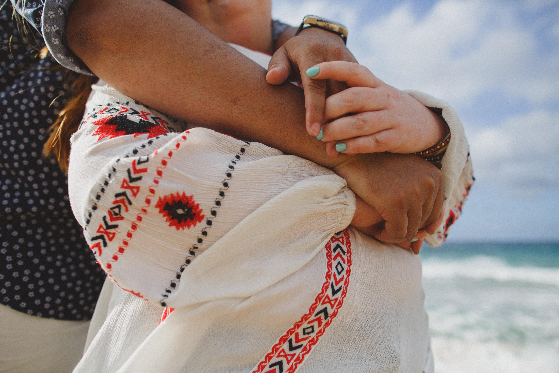 Couple embracing on Maui beach