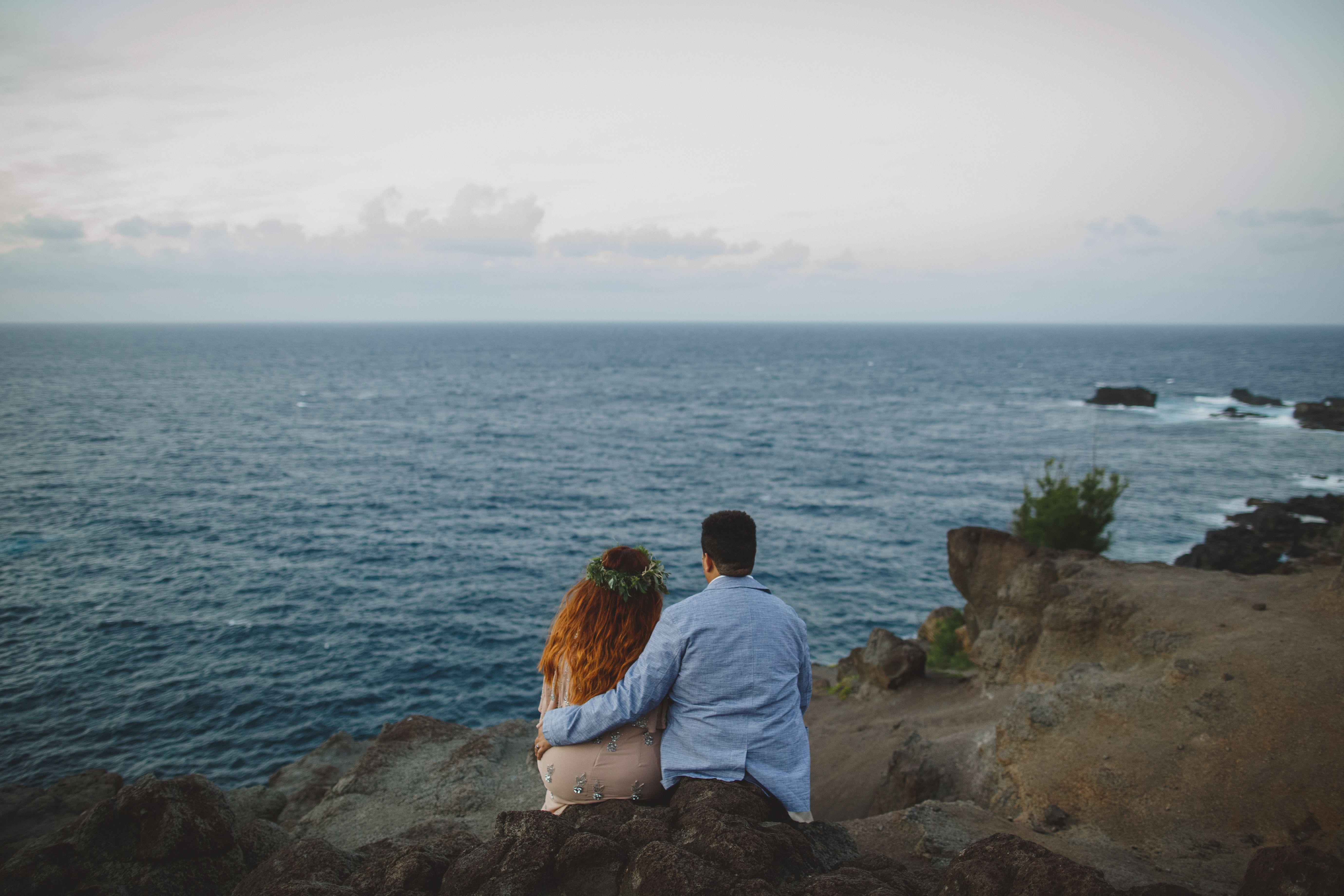 How to Survive a Season of Waiting. Couple sitting on a rock formation overlooking the ocean in Maui Hawaii